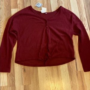 Red/ burgundy sweater fits like a medium/large